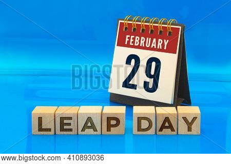 A Calendar Page On February 29 With Wooden Blocks With The Text Leap Day On A Blue Background. Conce