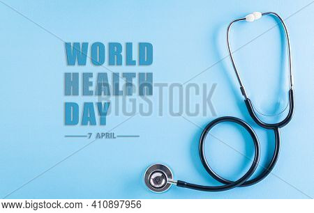 World Health Day, Healthcare And Medical Concept. Stethoscope On Pastel Blue Background With The Tex