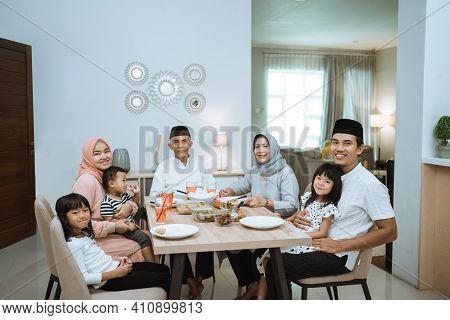 Muslim Asian Family And Grandparents Having Break Fasting On Ramadan