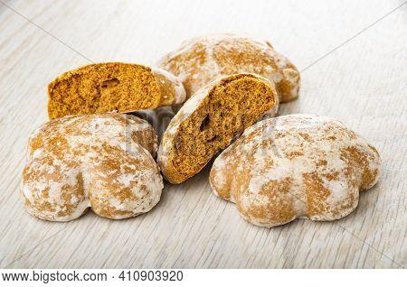 Few Whole Gingerbreads, Broken Gingerbread On Light Wooden Table