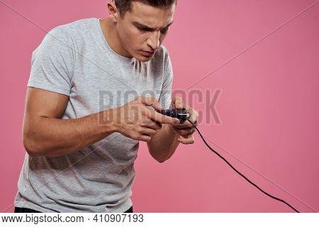 Man Wearing White T-shirt Console Joystick Games Craze Technology Pink Background