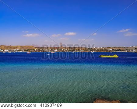 Panorama Of Sharm El-maya Bay With A Yellow Tourist Boat In The Turquoise-azure Water Of The Red Sea