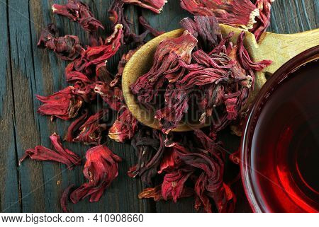 Hibiscus Tea. Hibiscus Tea In A Wooden Scoop And Cup Of Fresh Tea. Top View.  Vitamin Tea For Cold A