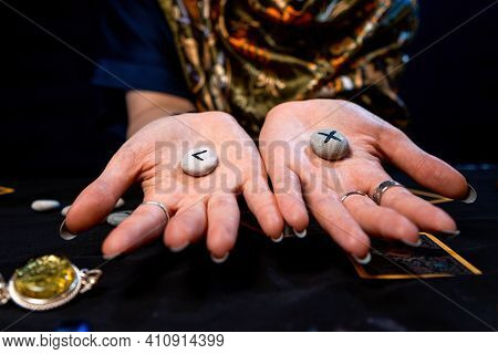 On The Palms Of The Fortune Teller Are Runes. Close Up. The Concept Of Divination, Astrology And Eso
