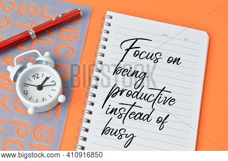 Motivational Quote Written With Focus On Being Productive Instead Of Busy.