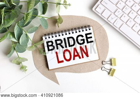 Bridge Loan. Text On White Notepad Paper On Light Background
