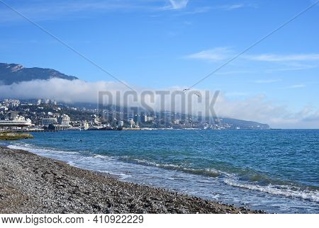 Yalta City In Republic Of Crimea, Russia. Cityscape And Waterfront Views From The Beach