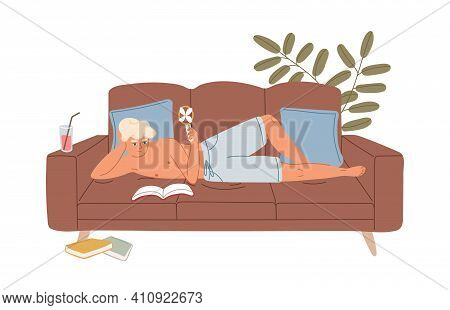 Person Relaxing On Sofa With Handheld Electric Mini Fan Blowing Cool Air On Hot Summer Day. Young Ma