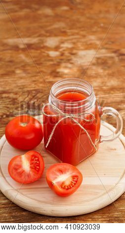 Glass Of Tomato Juice On Wooden Table. Fresh Tomato Juice And Chopped Tomatoes On Wooden Board. Vert