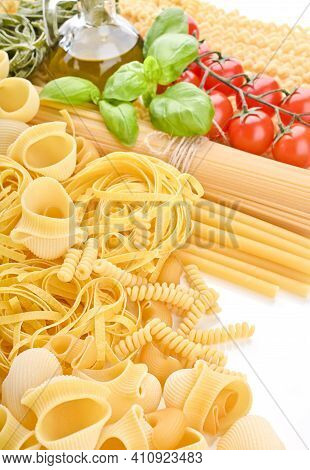 A Group Of Different Types Of Italian Pasta. Pasta With Fresh Tomatoes, Basil And Olive Oil On Light