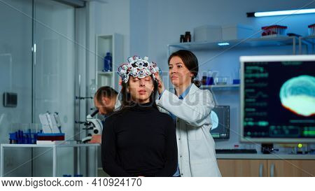 Asistance Of Neurological Doctor Putting Eeg Headset On Patient Head Scaning Brain Functions, Descov