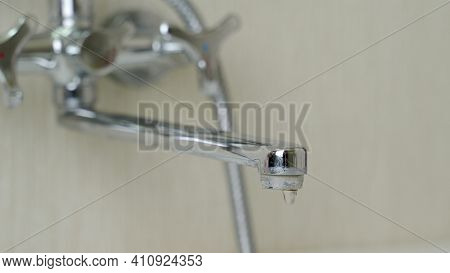 Leaking Water Faucet. Water Drops Falling Out Of Faucet