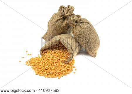 Peas In A Bag, Isolated On A White Background.split Peas In Burlap. Healthy Food.yellow Split Peas I