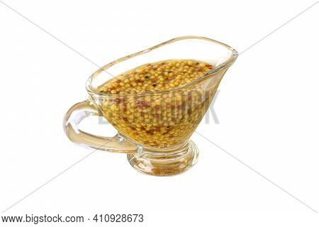 Mustard With Grains In A Glass Pan Is Isolated On A White Background, Macro