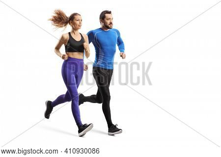 Full length shot of a young man and woman in sportswear running together isolated on white background