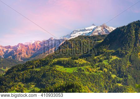 Switzerland, Jungfraujoch, Swiss Alps Autumn Landscape With Colorful Snow White And Pink Rocky Mount