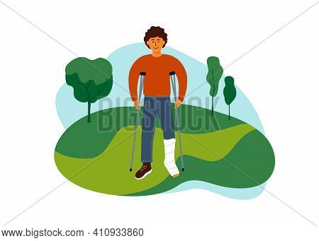 Young Man With Broken Leg Walking On Nature Park. Disabled Guy With Crutches Enjoying Life. Outdoor