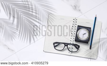 Flat Lay Of Blank Spiral Notebook, Pencil, Eyeglasses And Vintage Travel Leather Case Pocket Watch W