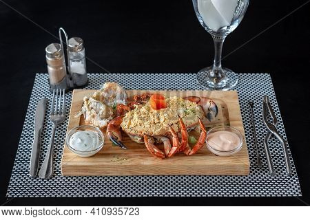 Crab Shell Stuffed With A Paste Made Of Egg, Mayonnaise And Crab Meat, With Two Dipping Sauces On A