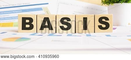 Basis Word On Wooden Cubes. The Background Is A Business Graphs. Finance Concept