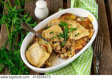 Homemade Oven Baked Potato Gratin With Ground Beef, Cheese And Garlic