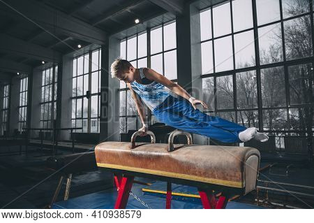 Strong. Little Male Gymnast Training In Gym, Composed And Active. Caucasian Fit Boy, Athlete In Spor