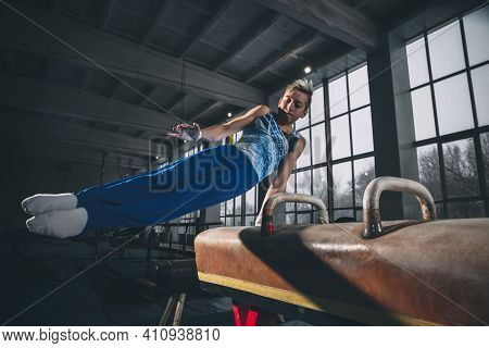 Leader. Little Male Gymnast Training In Gym, Composed And Active. Caucasian Fit Boy, Athlete In Spor