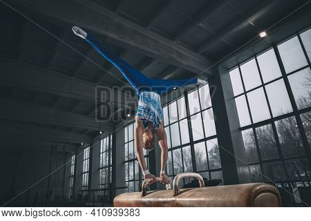 Future. Little Male Gymnast Training In Gym, Composed And Active. Caucasian Fit Boy, Athlete In Spor