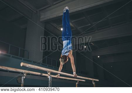 Energy. Little Male Gymnast Training In Gym, Composed And Active. Caucasian Fit Boy, Athlete In Spor