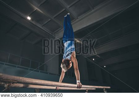 Skillful. Little Male Gymnast Training In Gym, Composed And Active. Caucasian Fit Boy, Athlete In Sp