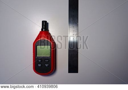 Hygrometer For Measuring Air Humidity, Close-up And Details. A Device For Measuring Humidity And Tem