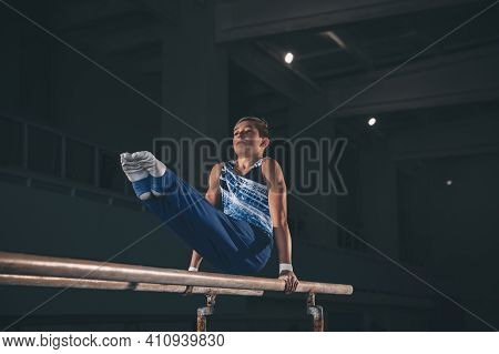 Experience. Little Male Gymnast Training In Gym, Composed And Active. Caucasian Fit Boy, Athlete In