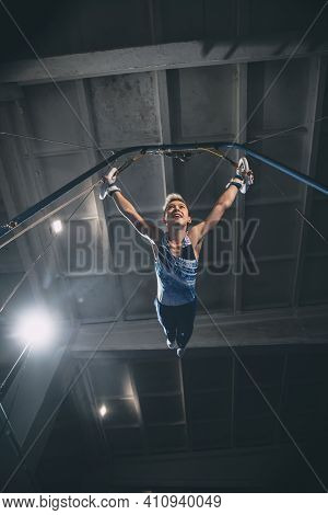 Flying. Little Male Gymnast Training In Gym, Composed And Active. Caucasian Fit Boy, Athlete In Spor