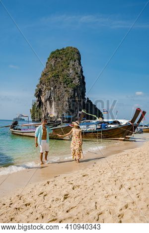 Couple Mid Age On A Tropical Beach In Thailand, Tourist On A White Tropical Beach, Railay Beach With