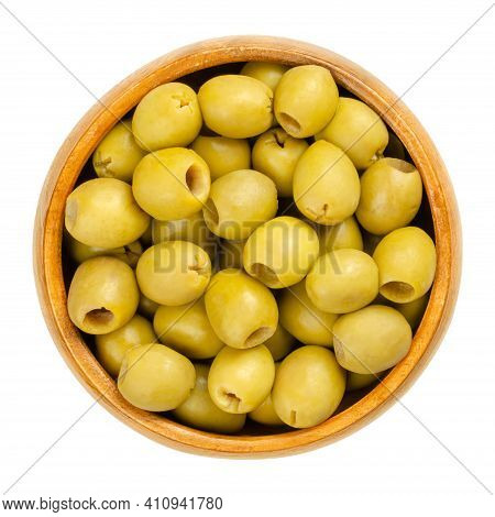 Pickled And Pitted Small Green Table Olives In A Wooden Bowl. Green Fruits Of Olea Europaea, Unripe
