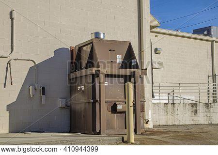 Columbia County, Ga Usa - 01 30 21: Wall Trash Compactor On A Building