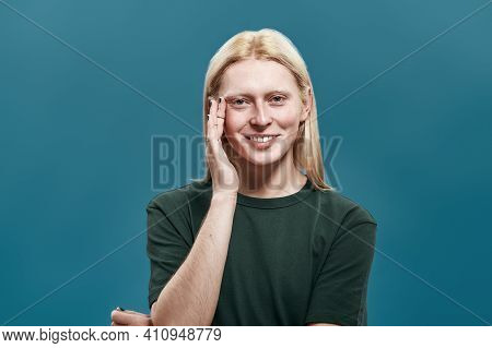 Groomed Young Caucasian Man With Long Blond Hair And Manicured Hands Smiling At Camera While Posing