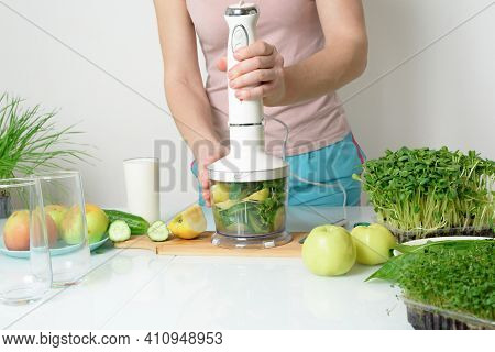 Step-by-step Recipe For Making Smoothies From Micro-green Apples Cucumber And Spinach. Woman Hands C