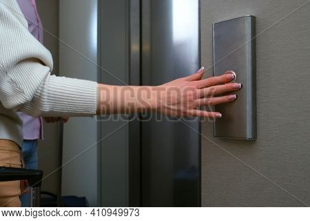 Hand Of Woman Pressing The Button Of Elewator And Waiting It. Female Hand Pushing The Button Of Lift