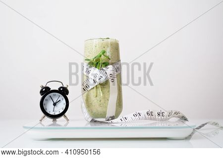 Smoothie Of Micro-green Apples Cucumber And Spinach On A Light Background. Waist And Body Measuremen