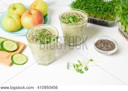 Smoothie Of Micro-green Apples Cucumber And Spinach On A Light Background. Eco Organic Fresh Food De