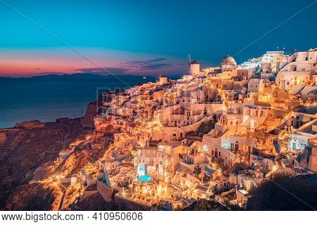 Beautiful View Of Fabulous Picturesque Village Of Oia With Traditional White Houses And Windmills In