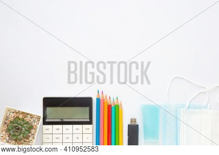 Blank White Paper Or Notebook With Stationary, Mask And Hand Sanitizer On White Background. Concept