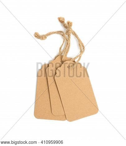 Blank Brown Rectangular Brown Paper Tag On A Rope Isolated On White Background, Template For Price,