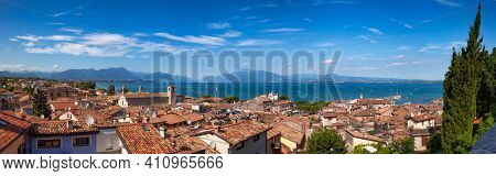 Panoramic view of Desenzano del Garda, a resort town on the shore of Lake Garda in Northern Italy. Lake Garda is the largest lake in Italy and a popular holiday location on the edge of the Dolomites