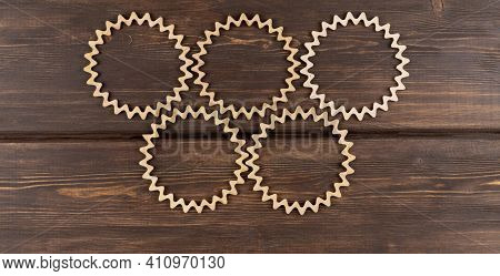 Background Of Carved Wooden Circles. Beautiful Vintage Wood Patterns. Laser Wood Carving. Round Wood