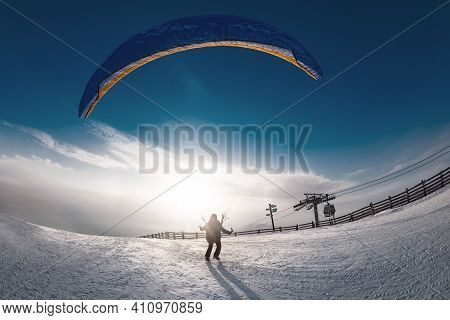 Lonely Skydiver Is Taking Off From Mountain Top At Ski Resort In Sunset Time. Sheregesh Resort, Sibe