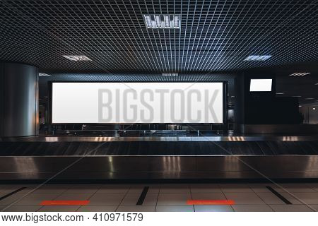 A Baggage Claim Area In A Hall Of A Contemporary Airport Arrival Zone With Luggage Conveyor Belt And