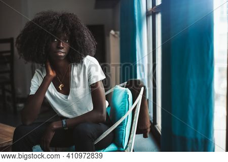 A Portrait Of A Charming Young African Female With Curly Hair And A Pendant In The Form Of Africa, S
