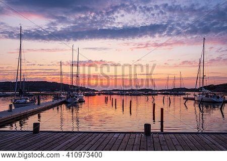 Sunset In The Port Of Fjaellbacka In Sweden.